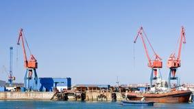 Cranes and boats Royalty Free Stock Photo