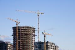 Cranes at building. Tall cranes at buiding site Royalty Free Stock Photos
