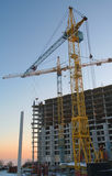 Cranes on building. Two cranes on winter building site Stock Photo