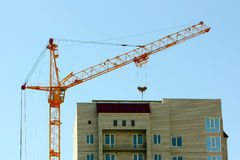 Cranes building against the blue sky. Stock Images