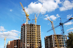 Cranes and building construction. Cranes and building on a background blue sky Stock Photo