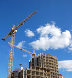 Cranes and building construction. Cranes and building on a background blue sky royalty free stock images