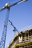 Cranes and building construction Stock Images