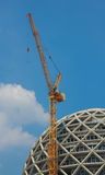 Cranes and building construction. On a background blue sky Stock Images