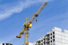 Cranes and building construction. Cranes and building construction on the blue sky Royalty Free Stock Image