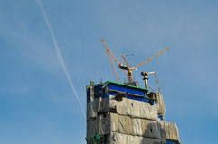 Cranes and building construction. Blue sky background Stock Image
