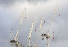 Cranes for building construction. With clouds in background Stock Image