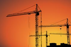 Cranes on building for construction industry Royalty Free Stock Images