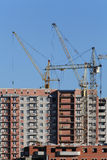 Cranes are building a house Stock Photography