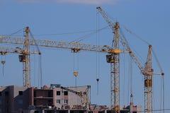Cranes building a house Royalty Free Stock Photos