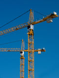 Cranes Building Two Stock Images