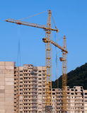 Cranes and building under construction Royalty Free Stock Photography