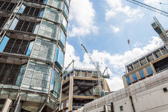 Cranes on a building under construction Royalty Free Stock Images