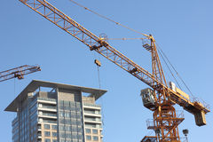 Cranes and buildings Stock Photography