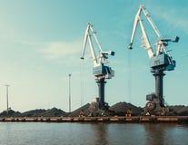 Cranes in the bulk terminal for loading bulk cargo. Two big cranes. Coal. Copy space stock image