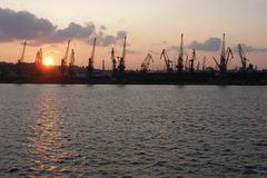 Cranes in the cargo port in Odessa at sunset Royalty Free Stock Photo