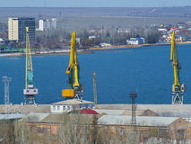 Cranes in a cargo port on the seashore royalty free stock images