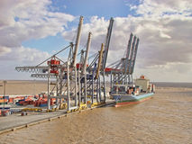 Cranes and cargo ship. At the port stock images