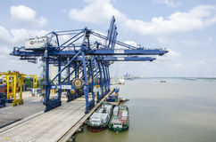 Cranes and cargo ships Stock Images