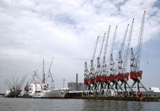 Cranes and carriers Stock Images