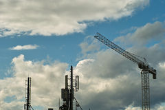 Cranes in clouds Stock Photography