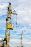 Cranes in the clouds. Yellow cranes in the clouds. Building and architecture Royalty Free Stock Image