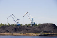 Cranes and coal. Royalty Free Stock Photography