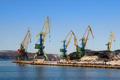 Cranes, coal and vessel. Port of Murmansk. Cranes loading coal royalty free stock image