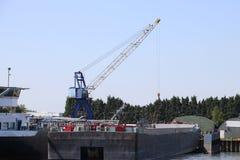 Cranes at the companies at riverside of river Noord between Krimpen aan den ijssel and Dordrecht. Cranes at the companies at riverside of river Noord between royalty free stock images