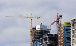 Cranes Constructing Commercial Office Buildings royalty free stock photography