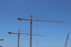 Cranes. Construction cranes on a blue sky Stock Images