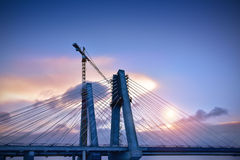 Cranes in construction of the cable-stayed bridge. Cracow Poland Stock Photos