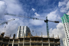Cranes and construction of microdistrict Stock Images
