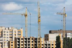 Cranes at the construction of multi-storey buildings.  stock photo