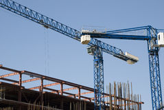 Cranes at construction site Royalty Free Stock Photo