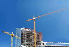 Cranes on construction site Royalty Free Stock Images