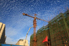 Cranes at construction site Stock Images