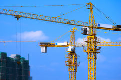 Cranes on construction site Stock Photo