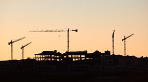 Cranes at a construction site Royalty Free Stock Photo