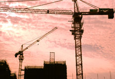 The cranes and construction site Royalty Free Stock Images