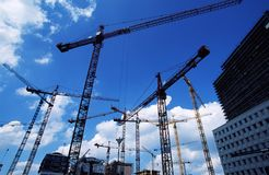 Cranes at construction site. Lots of cranes at construction site Royalty Free Stock Image