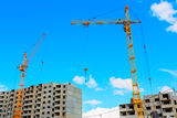 Cranes on the construction site Royalty Free Stock Images