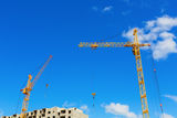 Cranes on the construction site Stock Photo