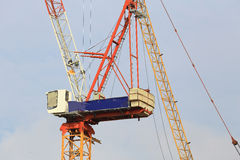 Cranes in construction site with blue sky. Cranes in construction site with blue sky, as architecture background Royalty Free Stock Photos
