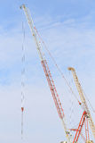 Cranes in construction site with blue sky and cloud. Cranes in construction site with blue sky and cloud, as architecture background or print card Stock Photo