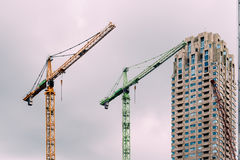 Cranes in construction site in the city of Rotterdam Royalty Free Stock Photo