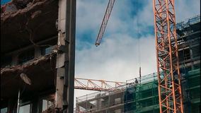 Cranes on construction site stock footage