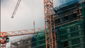 Cranes on construction site stock video footage