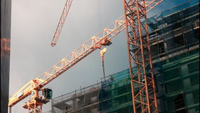 Cranes on construction site Royalty Free Stock Photography