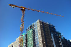 Cranes on construction site stock images